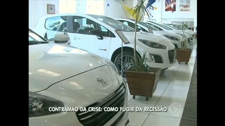 Para vencer crise, concessionárias apostam em descontos - Rede ...