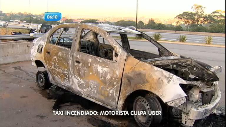 Taxista que teve carro incendiado acusa integrantes do Uber de ...